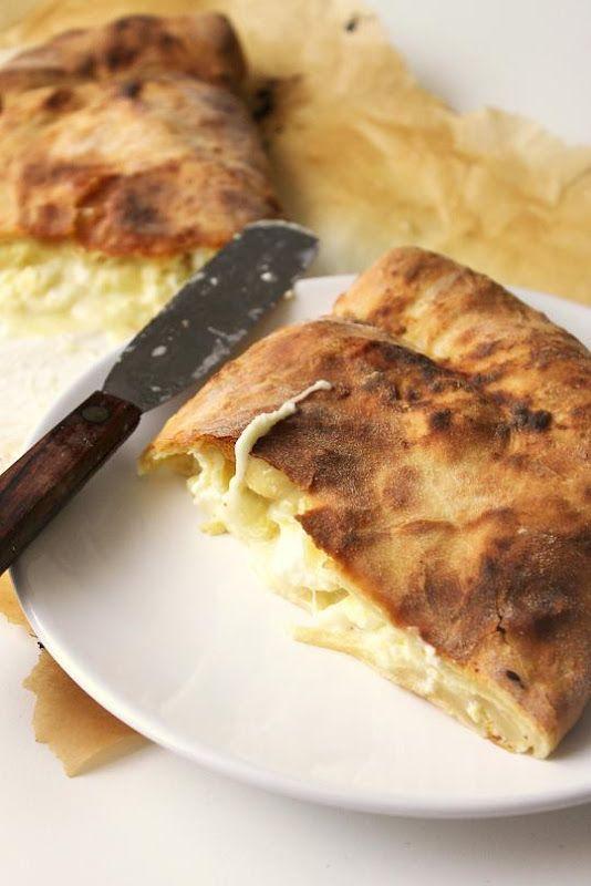 Khachapuri :: Georgian Cheese Bread *Ingredients* 700 g. flour 500 g. plain yogurt 2 eggs 50 g. butter, at room temperature 1 tsp. salt 2 tsp. baking soda Filling 450 g. fresh mozzarella (preferably buffalo milk mozzarella) 450 g. feta 1 egg
