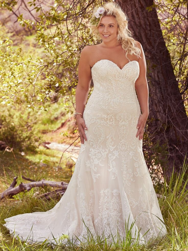 Maggie Sottero - ROSAMUND, Lovely in lace, this fit and flare plus size wedding dress is the epitome of beauty with bold lace appliqués laying atop tulle, cascading to a subtly flared skirt. Finished with sweetheart neckline and corset closure. Detachable lace cap-sleeves sold separately.