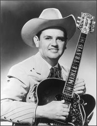"Merle Travis (b. November 29, 1917-d. October 20, 1983) Native of Rosewood, Muhlenberg County, Kentucky. Developer of a Kentucky guitar picking style known as ""thumb picking."" Inducted into the Country Music Hall of Fame in 1977."