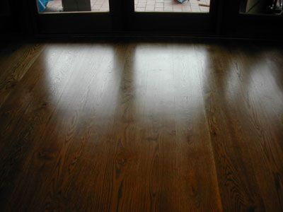 Black, walnut and teak brown stain over a new American oak flooring