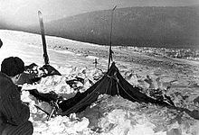 """Dyatlov Pass incident - investigators determined only that """"a compelling unknown force"""" had caused the deaths of 9 experienced skiers. It was determined that the hikers tore open their tent from within, departing barefoot into heavy snow and a temperature of −30 °C (−22 °F). Although the corpses showed no signs of struggle, two victims had fractured skulls, two had broken ribs, and one was missing her tongue. Their clothing, when tested, was found to be highly radioactive"""
