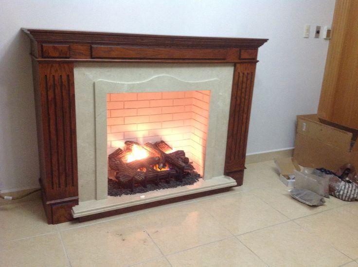 Chimenea de madera marmol y recubrimiento de cemento for Chimeneas de madera