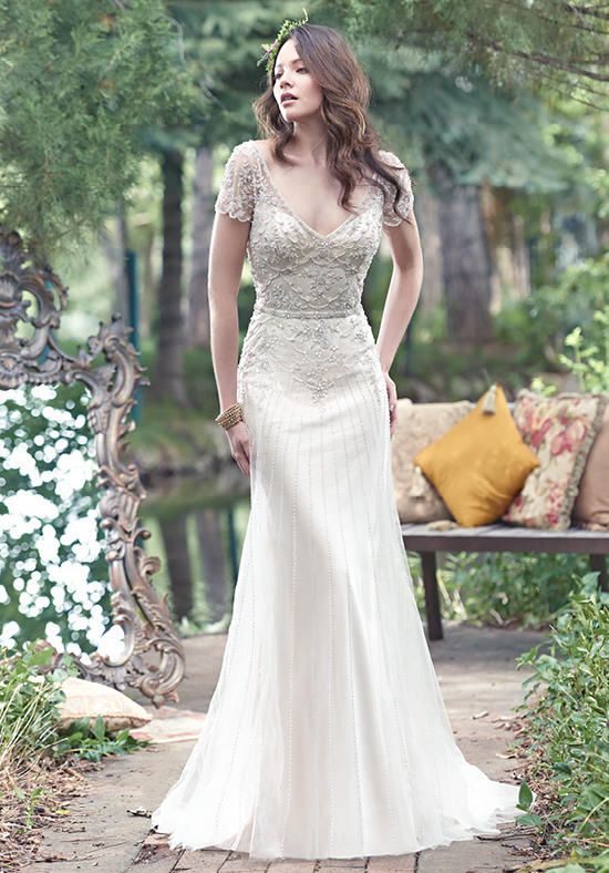 Maggie Sottero gown with a-line silhouette, V-neckline, deep-illusion back, short sleeves, beadwork,  and embroidery I Style: Amal I https://www.theknot.com/fashion/amal-maggie-sottero-wedding-dress?utm_source=pinterest.com&utm_medium=social&utm_content=june2016&utm_campaign=beauty-fashion&utm_simplereach=?sr_share=pinterest