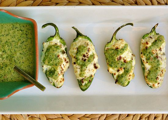 Grilled & Stuffed Jalapeños drizzled with Cilantro sauce: cream cheese, bacon, pepperjack cheese.  Yum!
