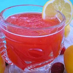 reception drink ideas: Luscious Slush Punch: This had a lovely red color, and tasted great! I found it definitely takes pre-planning, though, you'll need at least an hour for the punch to cool enough to pour into containers and then into the freezer. I've found one batch fits perfectly into 2 1-gallon Ziploc freezer bags. Just one night's freezing left it at the perfect slushy consistency, more than that and you have a solid, unpourable block o' frozen liquid.