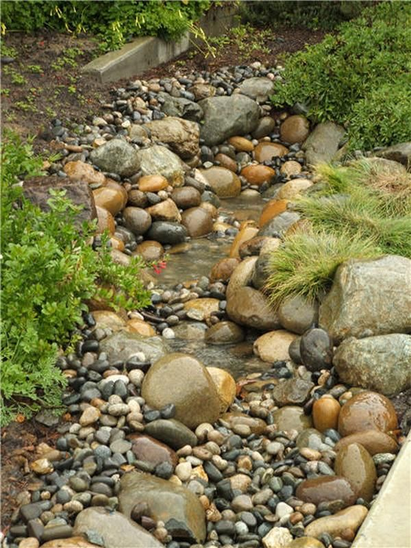 Dry creek bed.  Have been eyeing the spot for this for a few years.  Work in native grasses and perrenials.  This is a perfect balance of stone form and size.  (from The Owner-Builder Network)