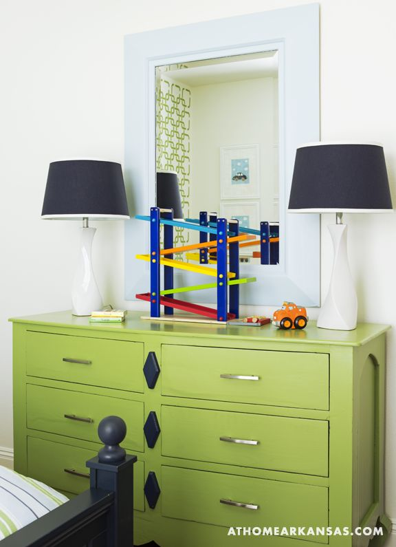 Bright green dresser with mirror.