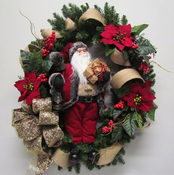 A rustic Santa looks right at home surrounded by burlap ribbon and poinsettia.