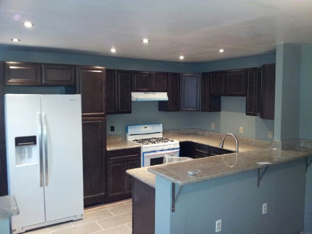 Dark Cabinets White Appliances Countertops Light Floor Shade White
