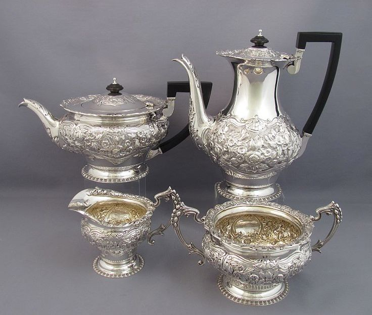 A handmade late Victorian silver tea set by William Gibson & John Langman, hallmarked London 1898. Beautifully chased in the Rococo style...