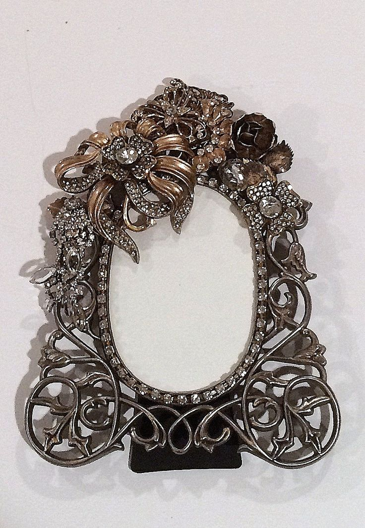 scrolly pewter picture frame enhanced with large gold colored and rhinestone jewels artistically placed to compliment the frame. by ArcMosaicsandJewels on Etsy