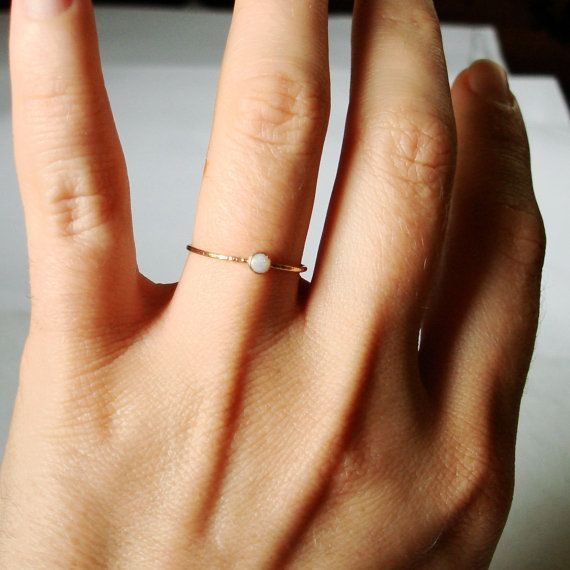 Items similar to Natural AAA Opal on a Thread of Gold - Simple Stacking Ring - Flashing Colors in a Tiny Fiery Stone - Delicate Jewelry on Etsy $31.00
