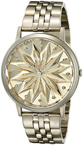 Fossil Women's ES3917 Vintage Muse Champagne Stainless Steel Watch. Gold-tone stainless steel bracelet watch featuring polished top ring and starburst tonal dial with crystal indices. 40 mm stainless steel case with mineral dial window. Quartz movement with analog display. Stainless steel band with fold-over clasp. Water resistant to 30 m (99 ft): In general, withstands splashes or brief immersion in water, but not suitable for swimming.