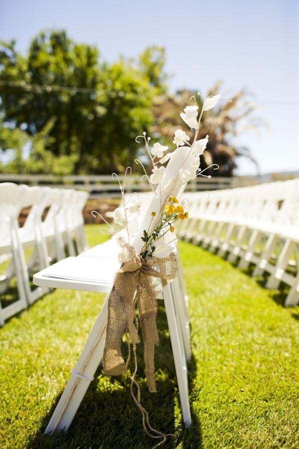 Burlap bows as wedding decor / pew decoration.