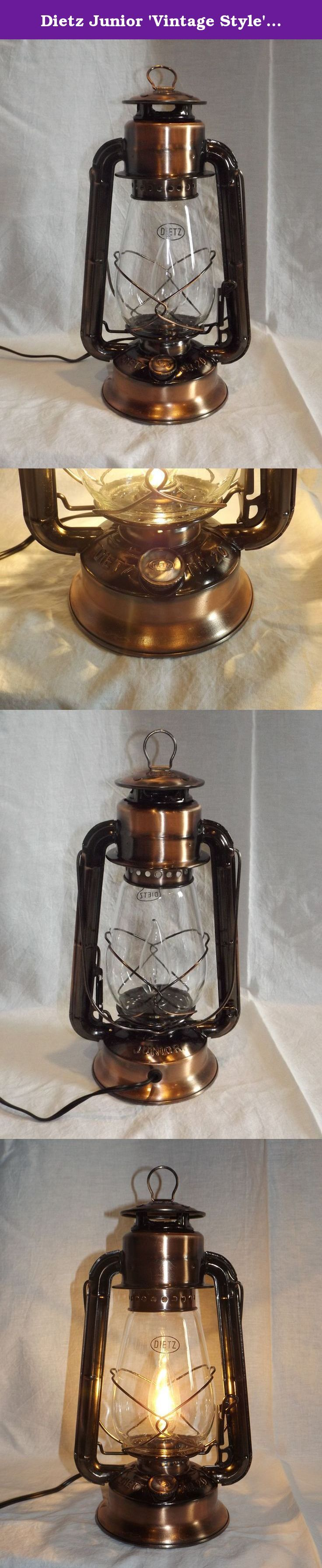 "Dietz Junior 'Vintage Style' Electric Lantern Table Lamp - Copper Bronze. Enjoy the glow of kerosene lantern lighting without the kerosene! Electric Lantern lighting provides safe, vintage style lighting without the mess or smell of kerosene oil. This Dietz Junior electric lantern lamp is 12"" tall (bail down) with a 5-1/4"" base, featuring a 7 foot electrical cord with in-line rotary on-off switch and replaceable candelabra base bulb (60-Watt maximum). This electric lantern lamp has been..."