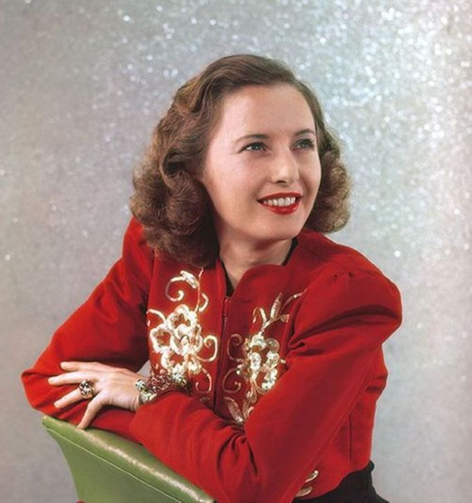 Barbara Stanwyck, 1938 color photo rare movie star vintage fashion icon red bolero jacket gold sequins beads portrait 30s 40s hair style