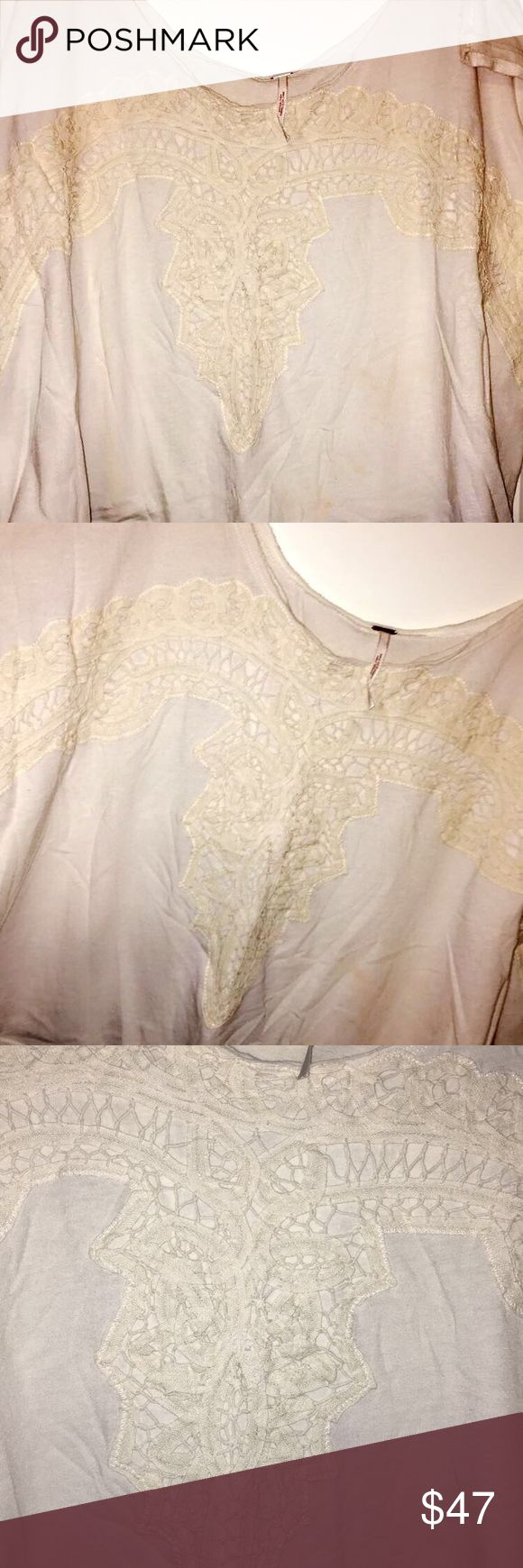 Free People Slouchy Lace-Detailed Tee This Free People slouchy-fit tee is perfect to throw on with jeans or shorts. It's a tan/cream color. It has lace detail on the front.  Women's size medium. Fits more short than long. Could possibly go off one shoulder casually.  Worn twice. In great condition! Free People Tops Tees - Short Sleeve