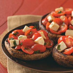 Grilled Portobellos with Mozzarella Salad Recipe....These colorful mushrooms are so filling, they're almost a meal in themselves. They can also be served with a small garden salad or as a hearty side dish.