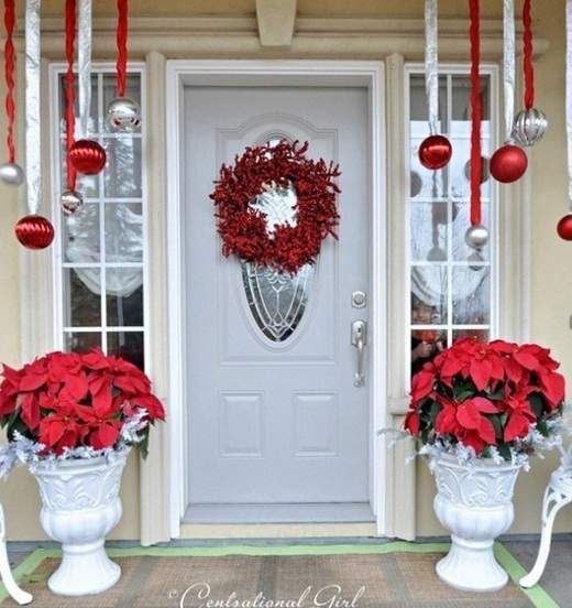 Hanging ornaments, berry wreath, red poinsettias...love it all!