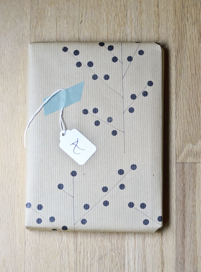 DIY - Hand-stamped wrapping paper using the eraser on a pencil and black ink. Fun idea!