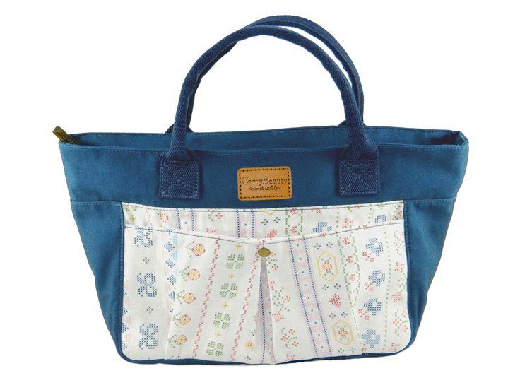 Water Resistance everyday handbag with personalised zip tab