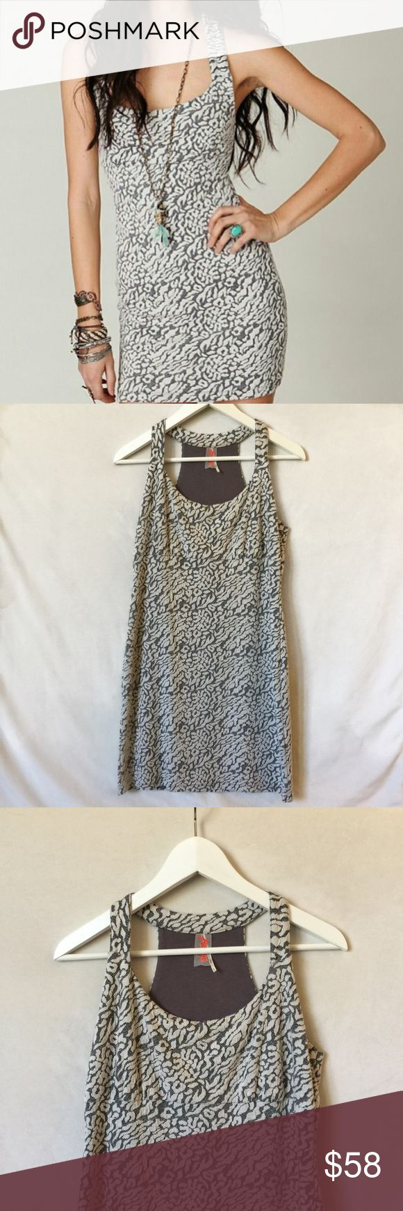 """Free People Animal Print Body-con Dress Soft and stretchy bodycon dress from Free People. Racerback and empire waist make this a flattering bodycon. Measures approx 15.5"""" from arm to arm pit and 33"""" in length. Excellent condition. Free People Dresses Mini"""