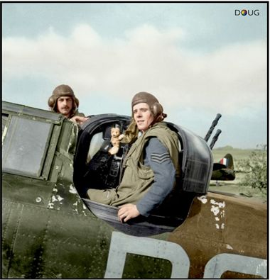 Flight Sergeant Edward Roland Thorn (pilot, left) and Sergeant Frederick J Barker (air gunner) of No 264 Squadron RAF and their Teddy Bear mascot, presented to them by their ground crew, posing with their Boulton-Paul Defiant Mark I L7005 - PS-B at Biggin Hill, Kent, after destroying their first Heinkel He 111. May/June1940
