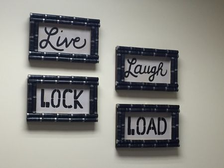 Live, Laugh, Lock, Load!  This set of 4 shotgun shell wall signs is a great way to integrate your love of guns with trendy home decor!