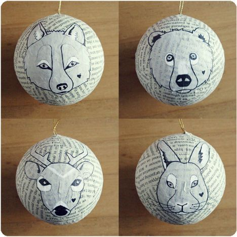 This cute project can revive even the ugliest, most dated ornaments or give purpose to random round objects like balls. Tori at Voyages of the Creative Variety applied bits of printed paper to round wooden ornaments with glue, and then painted and drew adorable animal faces on them. Get creative and go for your own subjects and color schemes.