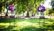 purple & green flowers in large round glass bowls at altar