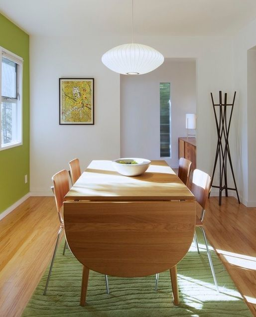 via Houzz | dining in style under a George Nelson Saucer Lamp | http://modernica.net/saucer-lamp.html