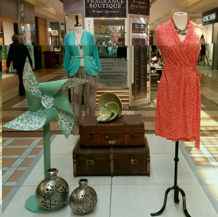 Something for the ladies... Fun colorful wrap dresses and tailored blazers on display by Poetry.