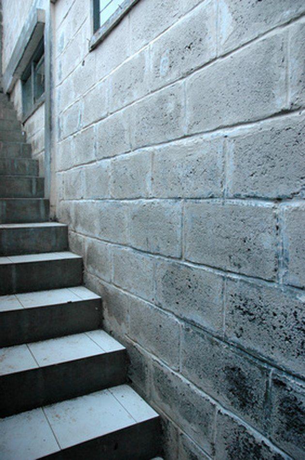 How To Paint Concrete Block Basement Walls Hunker Concrete Block Walls Basement Walls Painting Concrete