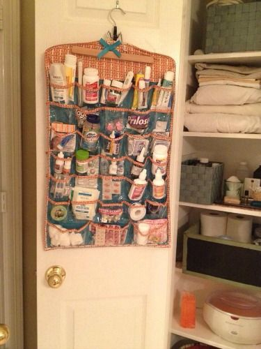 Use a hanging jewelry organizer used for organizing medications {featured on Home Storage Solutions 101}