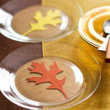 Felt leaves and burlap under clear glass plates
