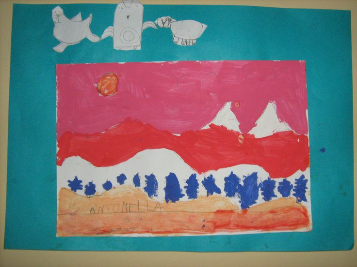 Students copied Ted Harrison paintings, glued them on construction paper and drew Northern Canadian animals (following simple instructions) to glue on the border. I was really impressed with these!