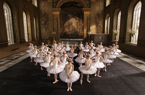 Ballerinas from the English National Ballet pose whilst wearing 3D glasses after Sky commissioned a performance of Swan Lake to capture the UK's first ballet for 3D TV, in The Painted Hall of the Old Royal Naval College, Greenwich on April 9, 2009 in London, England.