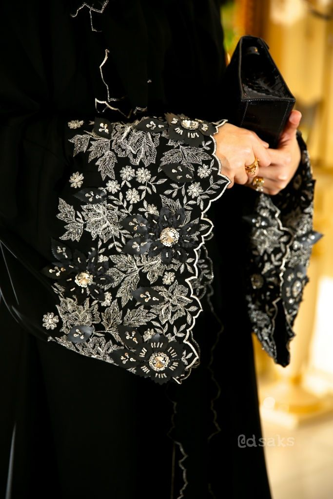 Dsaks wearing abaya by Hania                                                                                                                                                                                 More