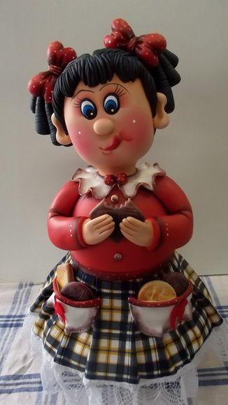 Pote Menina bolacha III  Pote de 1,3 L, trabalhado em biscuit em forma de menina comendo bolacha.  Pote utilitário.  Veja mais modelos no mostruário.    ENCOMENDAS: O PRAZO DE CONFECÇÃO É DE 45 DIAS A PARTIR DA DATA DO AGENDAMENTO. FAVOR CONSULTAR MÊS PARA AGENDAMENTO.    O AGENDAMENTO DO PEDIDO ...