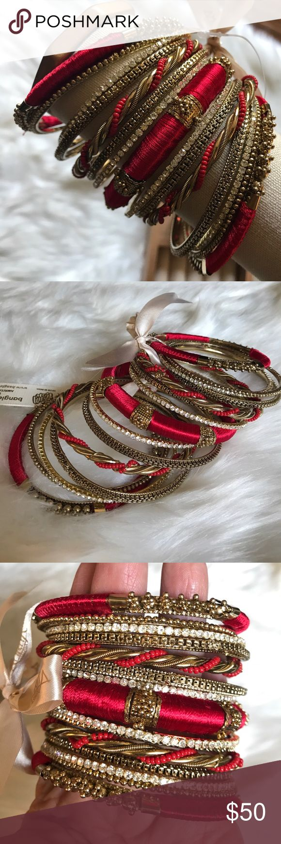 "Amrita Singh Bangle Bangle 15 piece Bracelet Set Amrita Singh Bangle Bangle 15 piece Bracelet Set. 15 piece layered Antique gold-tone brass Bangle set embellished with red silk thread, resin beads and clear Austrian crystals. Size 8 (20.32 cm). Stacked width 2.5"". Amrita Singh Jewelry Bracelets"