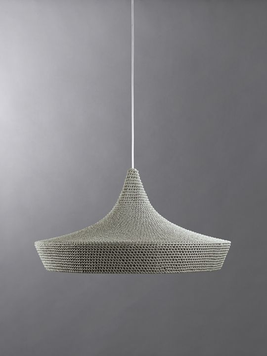 CAVE & VEX are stout yet elegant shades with tessellating 20 degree angled edges. Perfectly complimenting one another these two shades work side by side, as dramatic tiered modular chandeliers or as single low illuminating light shades. The expertly hand constructed textile finish softens the light whilst the broad open base allows for maximum directional brightness.