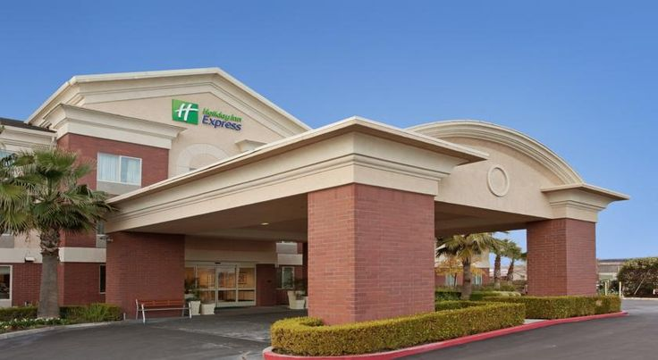 Holiday Inn Express Woodland Woodland Off Interstate 5 and a 10 minute drive from Woodland Opera House, this California hotel provides free airport shuttles to Sacramento International Airport. Spacious rooms include free Wi-Fi and a refrigerator.