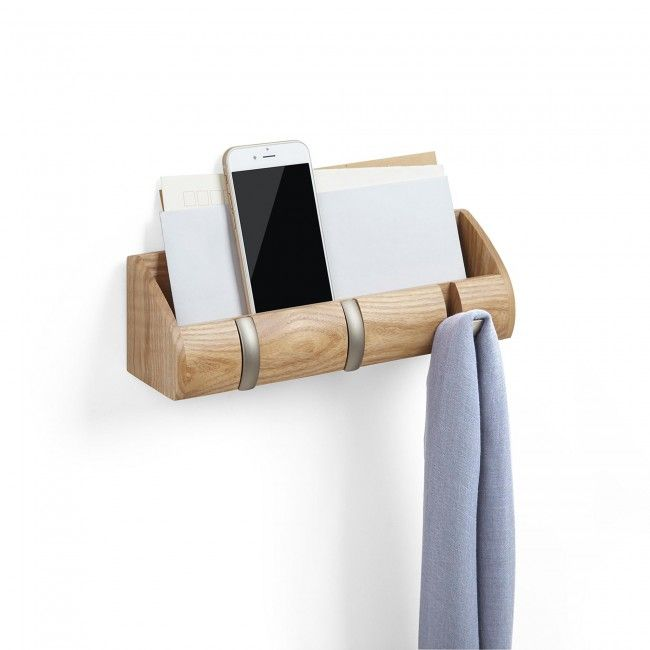 A wooden cubby with 3 built in flip style hooks. Cubby holds mail, keys, cell and wallet to keep the entryway free from clutter.