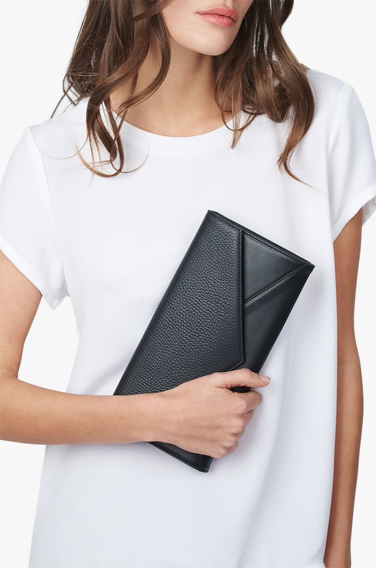 Realized in a modern mixed-media design, our fresh take on the envelope clutch is crafted in Italy from a rich blend of smooth and textured Italian leathers. Its clean, minimal silhouette and discreet magnetic closure convey a sophisticated sensibility. Finished with a spacious interior of pockets, this sleek essential provides easy organization, while adding a refined punctuation point to your day or evening.