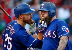 Rangers to decline option on Mike Napoli's contract for 2018  -  October 17, 2017:  Image:  Texas Rangers Mike Napoli (right) and teammate Jonathan Lucroy (25) pull on each others bears after Napoli hit a third inning home run against the Miami Marlins at Globe Life Park in Arlington, Tuesday, July 25, 2017. (Tom Fox/The Dallas Morning News)
