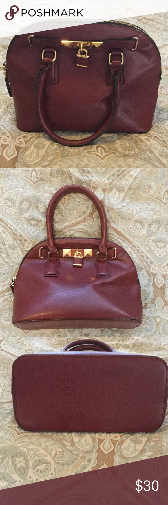 Burgundy Aldo purse Gold accents on the purse. Two handle purse that zips up.....One zip up pocket medium size and the other side inside the purse are 2 pockets. Black lining. The pockets are accented with the burgundy color. Gently worn purse . I believe you would consider this a satchel type purse. Aldo Bags Satchels