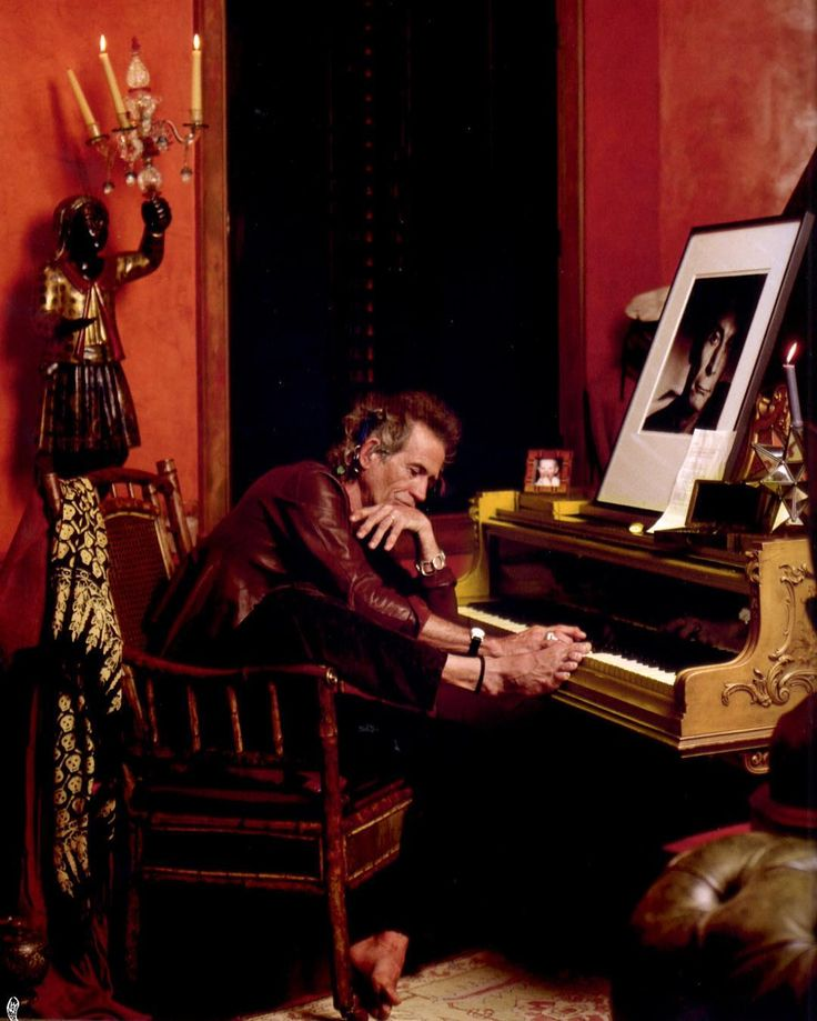 Keith Richards in the music room of his Connecticut Home Photographer: Deborah Feingold  #deborahfeingold #keithrichards #musician #artist #guitarist #rollingstones #home #conneticut #usa #interior #lifestyle #living #music #musicroom #red #interiordecor #interiordesign #decor #style #elegant #stylish #dramatic #glamorous #art  #architecture