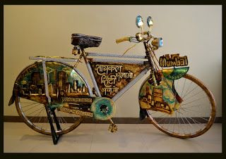 "Gold Leaf & Metal Embossed Creative MUMBAI CYCLE, design by Indian artist Rajesh Nakar, This cycle talk about ""Ride the cycle & make your city Pollution Free"""