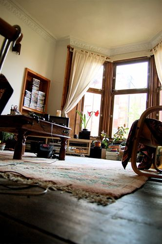 living room by twistyfoldy.net, via Flickr. Texture. Dark hardwood floors. Walnut. Cherrywood. Rustic. Cozy. Shabby chic. Textiles. Built-in bookshelf.