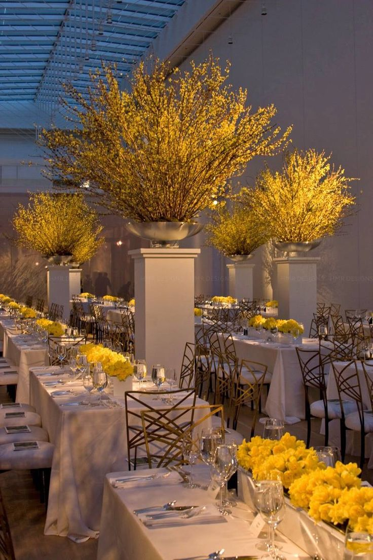 I like the yellow roses in square vases.